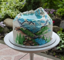 кремовый торт с горами и озером